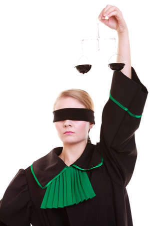 advocate symbol: Law court concept. Woman lawyer attorney wearing classic polish (Poland) black green gown with covered eyes holds scales. Femida - symbol sign of justice. isolated on white background Stock Photo