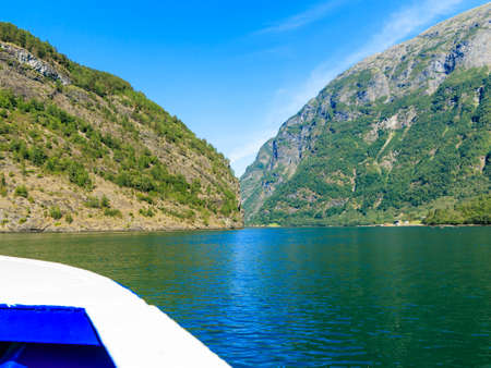 sognefjord: Tourism vacation and travel. Mountains and fjord Sognefjord in Norway, Scandinavia. View from boat