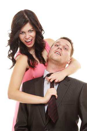 emancipation: Emancipation. Woman pulling tie of man, female showing her domination over male isolated on white.