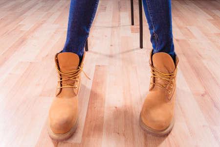 girl soles: Legs in leather warm brown winter boots indoor Stock Photo