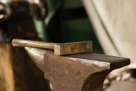blacksmith shop: Tools - hammer and anvil used by a blacksmith in old shop