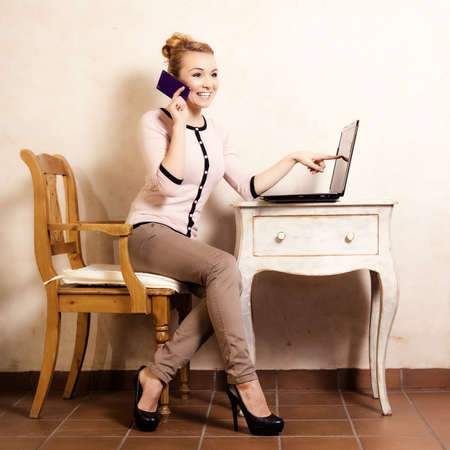 Technology internet modern lifestyle. Full length of businesswoman woman student girl talking on mobile phone smartphone touching screen of computer laptop. photo