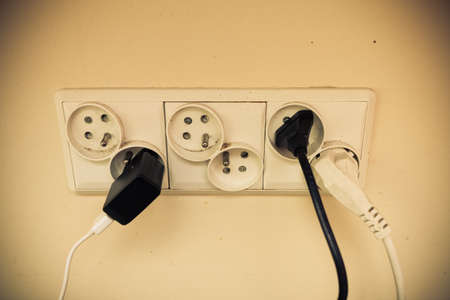 plug in: Electricity in house. Unclean like dangerous concept. Dirty electric plug in socket for power. Stock Photo