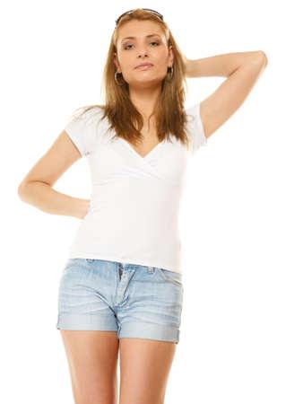 Summer fashion. Pretty young woman sensual girl in denim shorts isolated on white 版權商用圖片