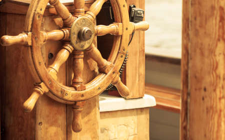 yachting: Yachting. Sailboat view of different parts of yacht. Ship wooden old steering wheel.
