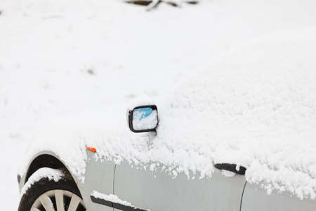immobile: Winter season and seasonal specific. car covered in snow closeup