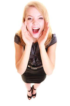 screaming girl: young woman blonde buisnesswoman in black dress shouting screaming. girl calling for help isolated on white