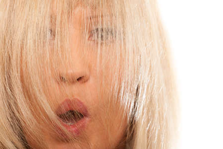 hairstyling: Healthy hair hairdressing concept. Time for new hairstyling rejuvenation. Woman covering her face with long straight hair, surprised emotion Stock Photo