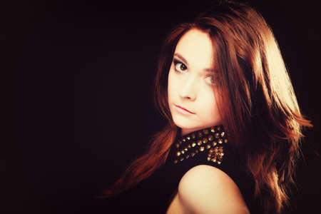 stud: Young people teenage concept - pensive serious woman portrait, fashion teenager girl wearing blouse with gold metal stud on black