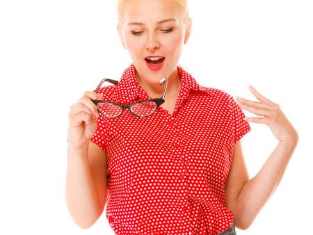 eyewear fashion: Eyewear. Fashion woman beautiful girl retro hairstyle holding new glasses looking surprised studio shot isolated on white Stock Photo