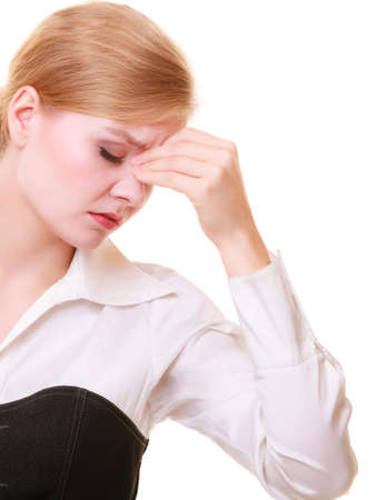 sinus: Headache, migraine and sinus ache. Stressed businesswoman worried young woman suffering from head or nose pain isolated on white. Stock Photo