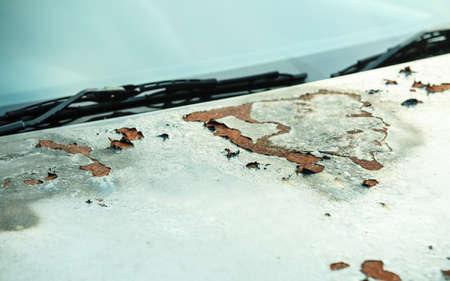 rusty car: Closeup rusty car detail with windscreen wiper Stock Photo