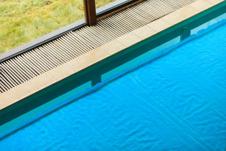 safety net: Relax active lifestyle or travel concept. Swimming pool at hotel close up, water covered with safety net grid