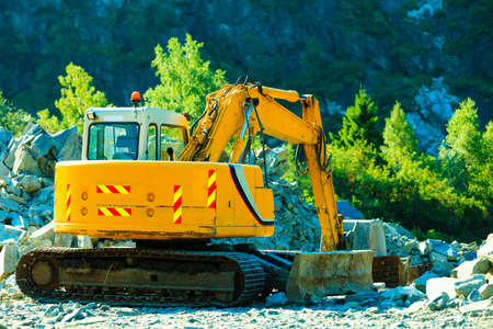 heavy industry: Industry, yellow heavy duty excavator machine, digger on construction site outdoor