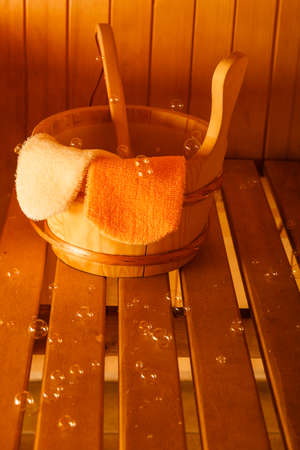 exfoliation: Beauty health spa and lifestyle concept. Interior of finnish sauna and accessories detail bucket ladle and exfoliation glove