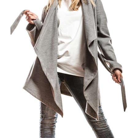 Fashion. Closeup fashionable woman in elegant gray belt coat isolated on white background