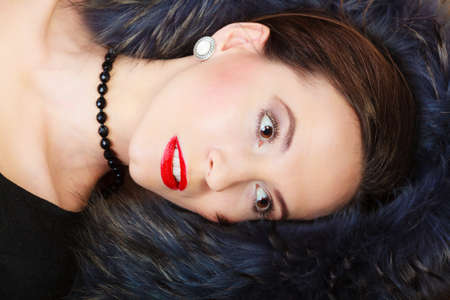 black boa: Fashion elegance and beauty. Woman in fur coat beautiful face makeup red lips, lady retro style portrait