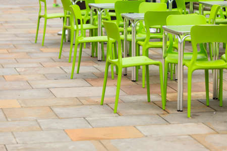 Outdoor restaurant coffee open air cafe green chairs with table. Summer vacation on resort photo