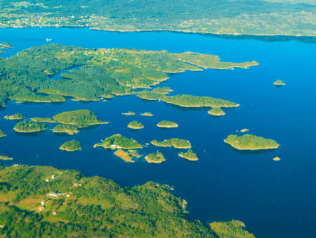 birds eye view: Birds eye. View from window of plane airplane flying over Norway Scandinavia.