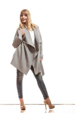 promotion girl: Fashion. Young blonde fashionable woman in elegant gray belt coat. Female model posing isolated on white background Stock Photo