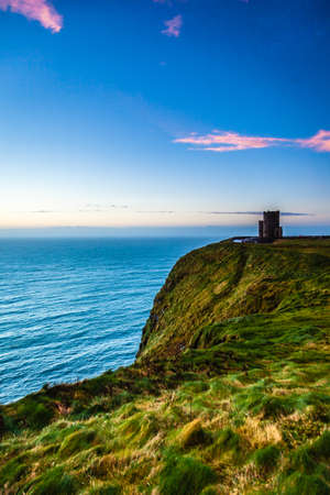 Cliffs of Moher at sunset - O Briens Tower in Co. Clare Ireland Europe. photo