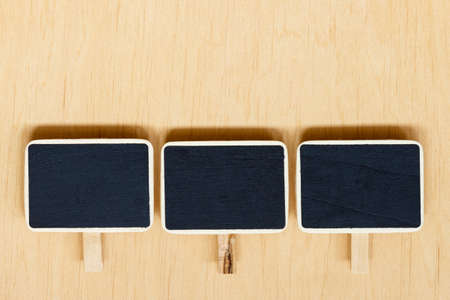 clip board: small blackboards slate chalk boards with space for text menu on wooden surface, empty blank sign Stock Photo