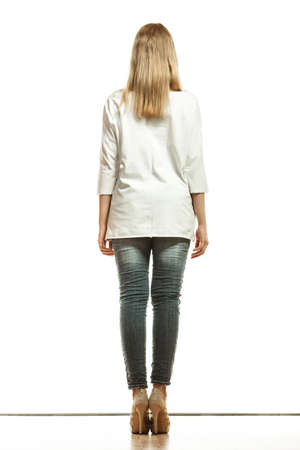 denim trousers: Fashion. Woman full length in denim trousers high heels shoes white blank top back view isolated