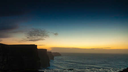cliffs: Famous cliffs of Moher at sunset in Co. Clare Ireland Europe. Beautiful landscape natural attraction.