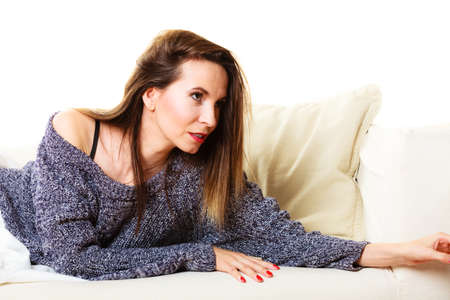power nap: Woman on sofa. Girl lying on couch relaxing or taking power nap after lunch.