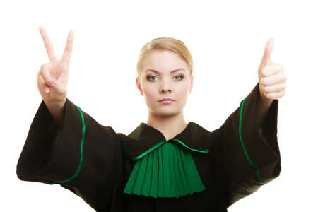 Law court or justice concept. woman lawyer attorney wearing classic polish black green gown making ok sign victory thumb up hand gesture isolated on white Stock Photo