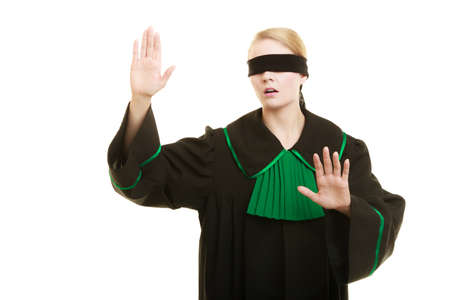 Blind justice. Woman lawyer attorney wearing classic polish (Poland) black green gown covering eyes with blindfold isolated on white