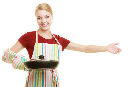 Happy housewife or chef in colorful kitchen apron with skillet frying pan isolated studio shot photo