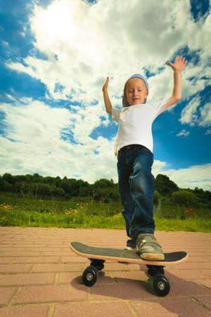 skater boy: Active childhood. Little man skateboarding. Skater boy child kid with his skateboard. Outdoor.