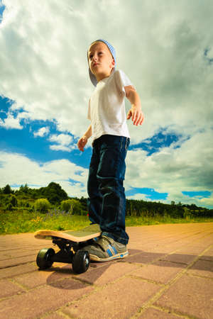 boy skater: Active childhood. Little man skateboarding. Skater boy child kid with his skateboard. Outdoor.