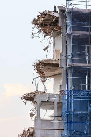 dismantling: Urban scene. Dismantling of a house. Ruins of building under destruction. Industry.