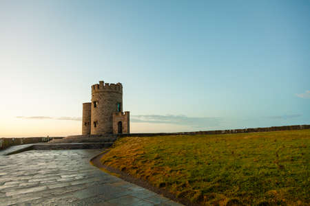 moher: Cliffs of Moher at sunset - O Briens Tower in Co. Clare Ireland Europe.