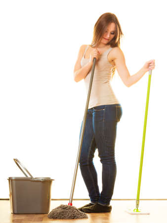 mops: Cleanup housework concept. cleaning girl young woman mopping floor, holding two mops new and old white background