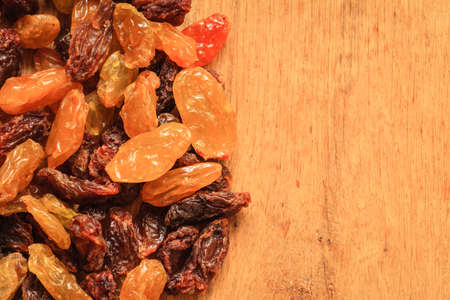 sultana: Healthy food organic nutrition. Border frame of raisin on wooden table background