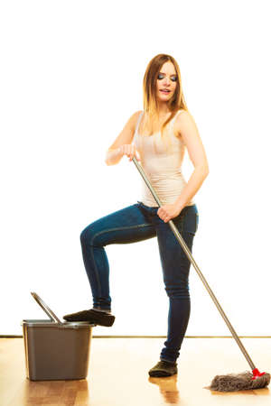 charwoman: Spring cleaning concept. young woman mopping floor, standing with old mop and bucket white background