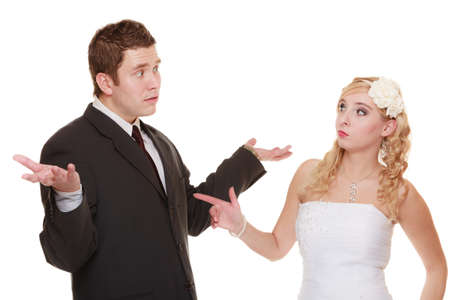 fury: Wedding couple having argument - conflict, bad relationships. Angry woman fury bride and groom in fight. Isolated