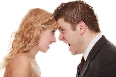 man yelling: Wedding couple relationship difficulties. Angry woman man yelling at each other. Portrait fury bride groom. Face to face. Negative bad communication human emotions facial expression.