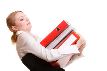 Business and paperwork. Young overworked businesswoman holding stack of folders documents. Busy woman working in office. photo