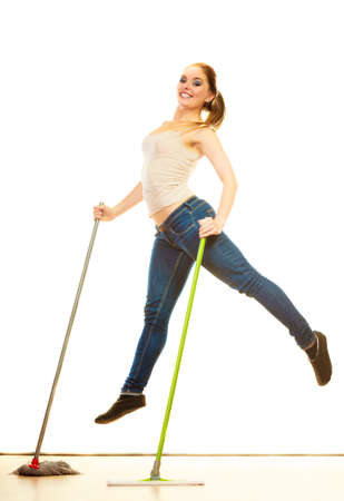 cleanup: Cleanup housework concept. Funny cleaning lady young woman mopping floor, holding two mops new and old jumping white background Stock Photo
