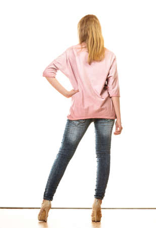 butt tight jeans: Fashion and people concept. Woman full length in denim trousers platform high heels shoes casual style back view isolated on white background