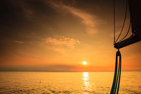 sailboat race: Yachting yacht sailboat sailing in baltic sea at sunset sunrise summer vacation. Tourism luxury lifestyle.