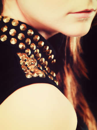 stud: Young people teenage concept - part of woman face, fashion teenager girl wearing blouse with gold metal stud on black