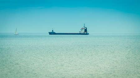 still water: Transportation, cargo conteiner ship sailing in still water near port of Gdansk Poland.