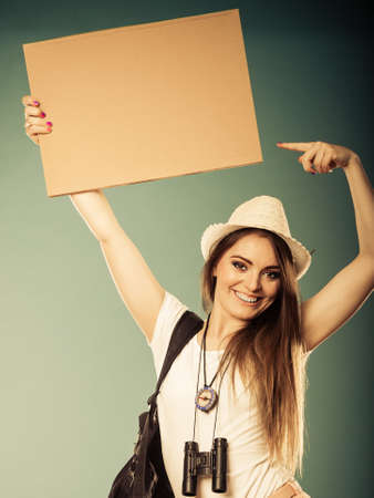 hitchhiking: Summer tourism active lifestyle concept. Woman happy female tourist hitchhiking with blank sign cardboard Stock Photo