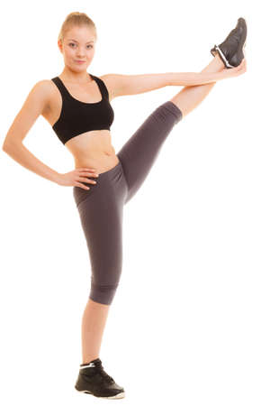 active lifestyle: Sport and active lifestyle. Sporty flexible girl fitness woman in sportswear doing stretching exercise isolated on white.