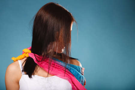woman fashionable: Summer fashion. Beauty young woman fashionable sensual girl with coloured shawl on blue